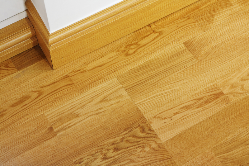 Laminate wooden flooring and skirting boards